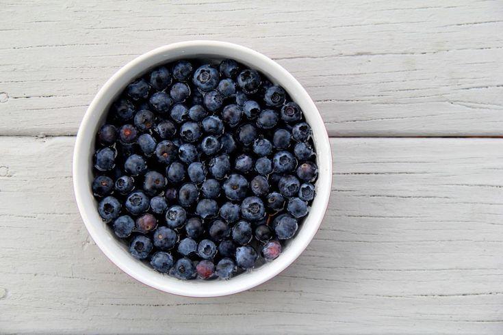 Rinsing blueberries by theresaSt.john