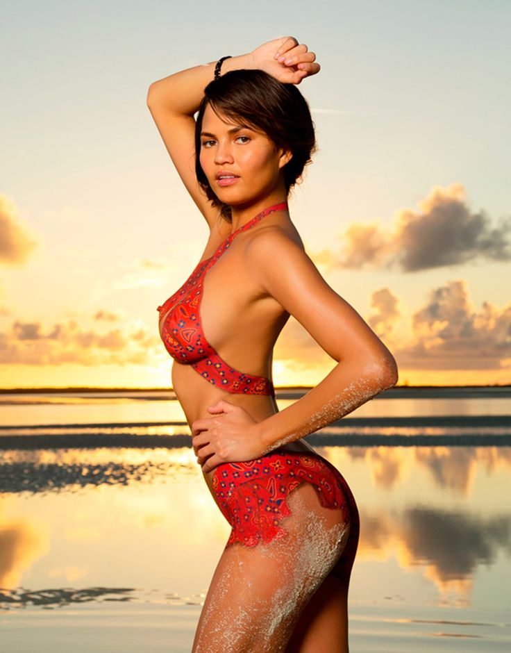 If It's Hip, It's Here: 2013 Sports Illustrated Bathing Suit Models In Nothing But Body Paint.