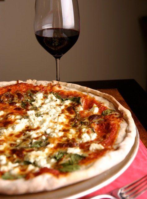 Spinach procuitto pizza