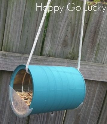 Make a bird feeder out of coffee can! Just cut the lid in half and glue one to each side of the coffee can.