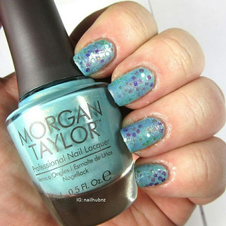 Blue polish with glitter added. Video up on my channel www.youtube.com/user/nailhubnz/videos