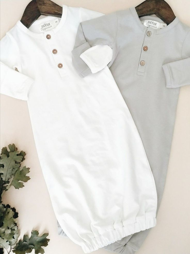 Super cute, gender neutral baby gowns. Shop this exclusive style from Lucy Lue Organics. www.lucylueorganics.com. Perfect as a newborn take home outfit or for a pregnancy announcement. Made of organic cotton. Simple modern style.