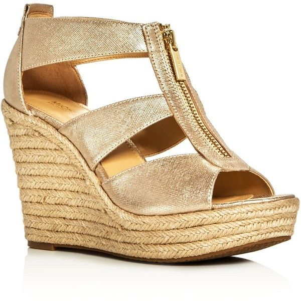 Michael Michael Kors Damita Metallic Caged Espadrille Wedge Sandals ($88) ❤ liked on Polyvore featuring shoes, sandals, pale gold, gold wedge sandals, cage sandals, metallic sandals, espadrille sandals and gold wedges shoes