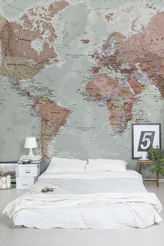 Sleep easy with this beautiful map mural above your head. Soft, muted and pastel tones make this world map wallpaper perfect for bedroom spaces. Pair with contemporary furnishings for a relaxed, toned down and modern look.