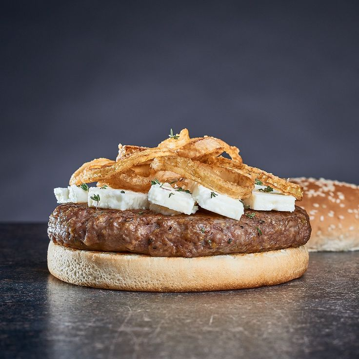 Lamb burger with thyme served with crispy onions, feta cheese and mint tzatziki.