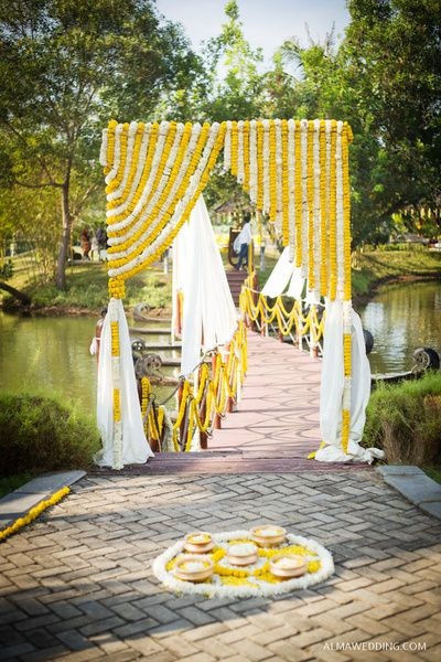 yellow and white rangoli, floral rangoli, yellow and white entrance, floral curtains