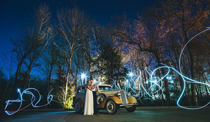 Even on a freezing Texas night Jamie and Matt were so excited and willing to bare the cold for us to get this long exposure wedding portrait of them in front of this classic car. This beautiful photo was taken at Ashton Gardens in Dallas, Texas. Photos like this are we we love being wedding photographers.