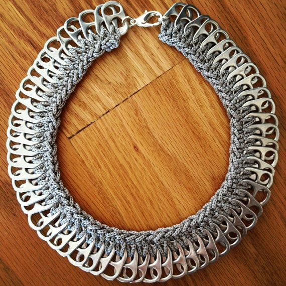 This is a very unique piece and often a conversation starter. It is handmade of aluminum pop/soda tabs that have been carefully cleaned and washed.    It is very lightweight.    The length of the necklace is 19cm.