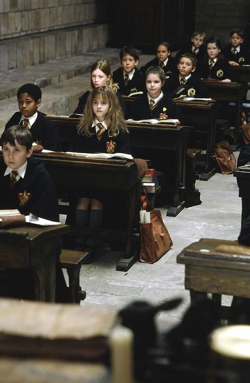 Such a great pic! Look at Emma's legs...she is sitting prim and proper in class....just like her character should!