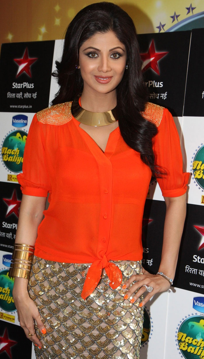 Nach Baliye judge Shilpa Shetty was bright and glittery in an orange top and golden skirt.
