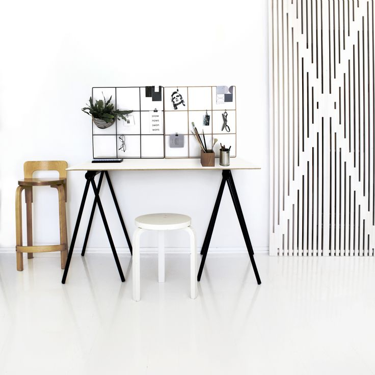 Nordic studio apartment | Minimalist workspace with Finnish Design: Alvar Aalto stools, Wallment metal wire grid memo board and XO doors