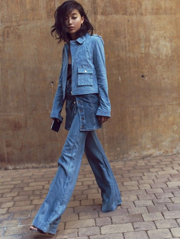 Margaret Zhang wears a denim jacket, camisole, denim skirt, and wide-leg jeans