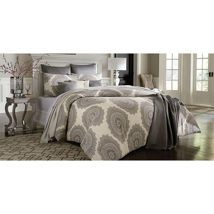 <p>Your bedroom blooms in beauty with the addition of this Cannon grey medallion comforter set. An eye-catching grey floral print on a soft off-white background is warm and inviting, while the plush cotton blend construction ensures all-night cozy comfort. With matching shams and pillows to complete the designer effect, this comforter set is stunning as well as practical.</p>