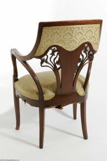 An Upholstered Marquetry Art Nouveau Armchair Emile Galle, attributed to. c. 1900 The mahogany, upholstered, scalloped