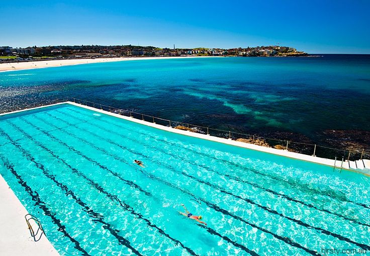 Bondi Beach – the stunning Icebergs pool enjoyed by a couple of swimmers on another picture perfect Sydney day