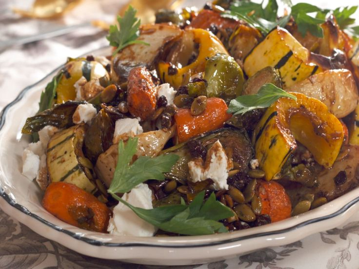 Roasted Vegetables Salad recipe from Nancy Fuller via Food Network. Might replace pumpkin seeds with pistachios