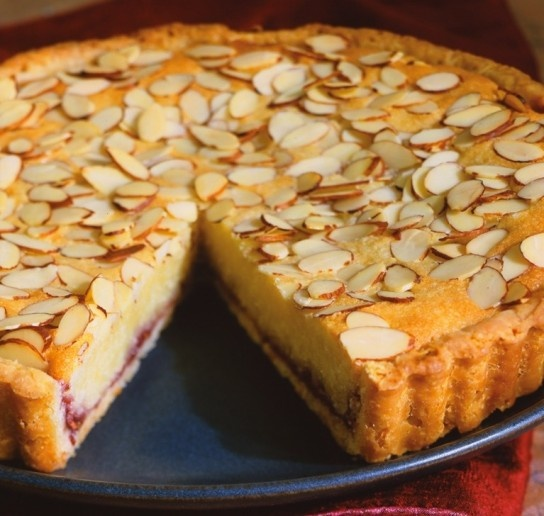 Can hardly wait to try this one - Italian Almond Tart.    Need:  1 rolled-out round of tart dough  8 Tbs. (1 stick) unsalted butter, at room temperature  1⁄2 lb. almond paste, cut into 1-inch cubes  1⁄4 cup sugar  2 eggs  1⁄3 cup unbleached all-purpose flour  1⁄3 cup raspberry, plum or cherry jam  1⁄3 cup sliced almonds