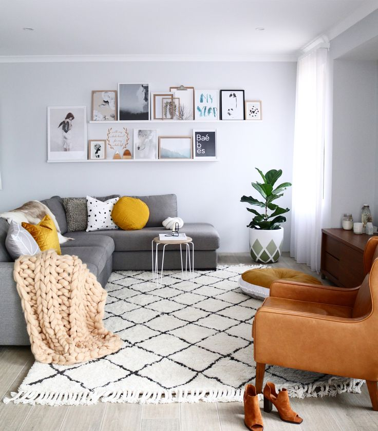 Scandi inspired living space / Lounge room. Lush floor rug and leather arm chair by Freedom Australia. Print will on a picture ledge making it easier to update the look of the space without pesky wall hooks.