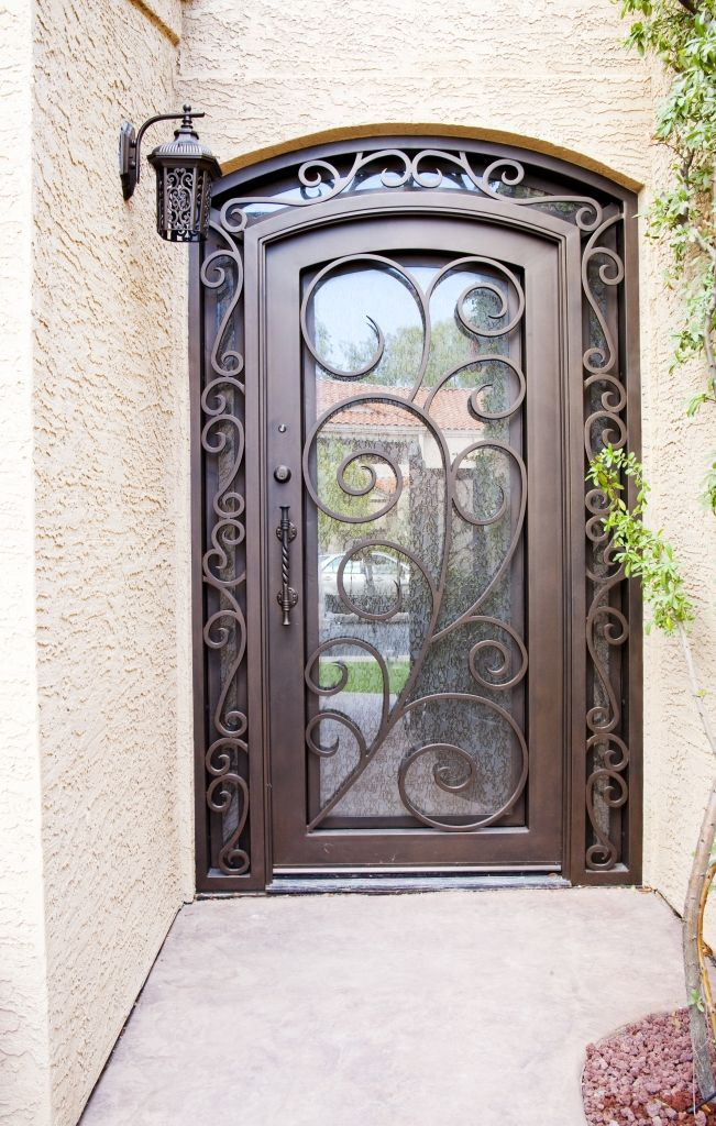 I like the small border around the door. Barcelona Iron Entry Doors #Firstimpression