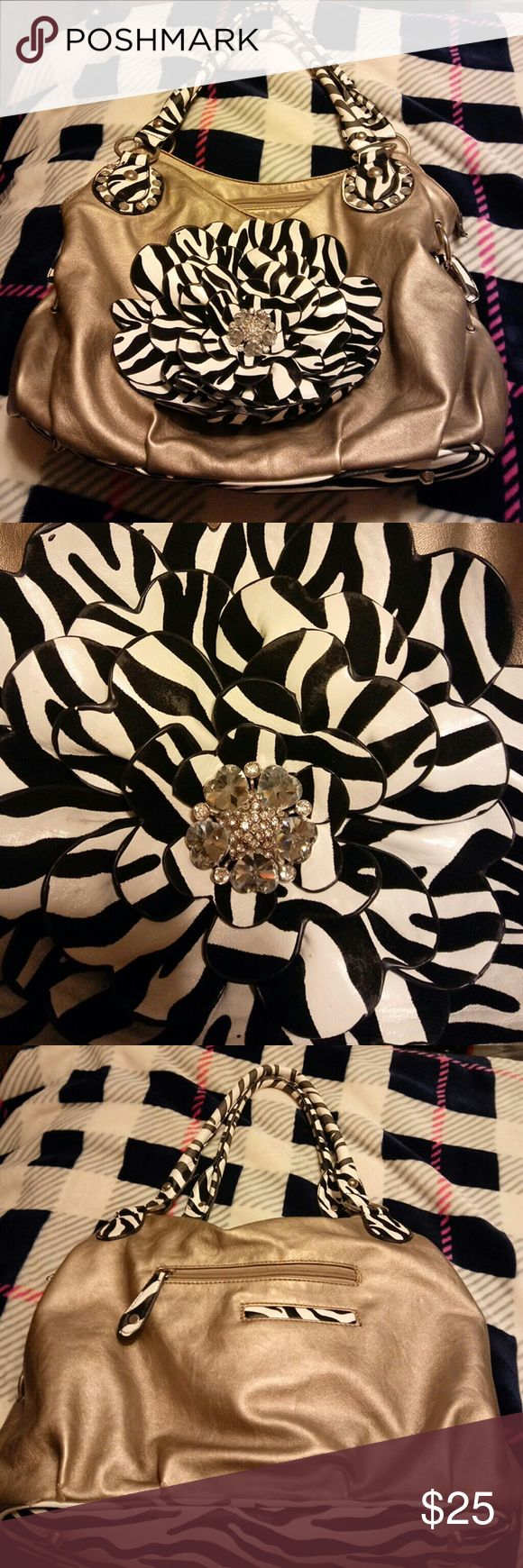 Gold black and white flower zebra fashion purse Make a statement hunni!! This is super cute and fun! Well taken care of with no known external blemishes. Inside is just work but still nice and clean. Bags Shoulder Bags