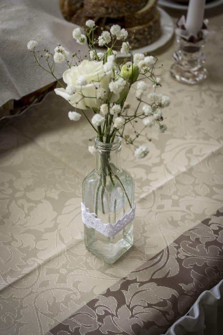 Wedding decoration, centrepiece, gypsophilla, lace on botle
