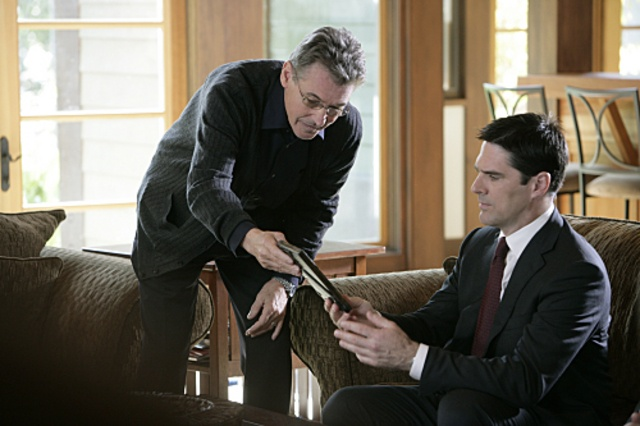 Mr. Gless (Guest Star: Randolph Mantooth) shows Agent Hotchner a photo of his son, who is a suspect in a murder case; from S4E14, Cold Comfort.