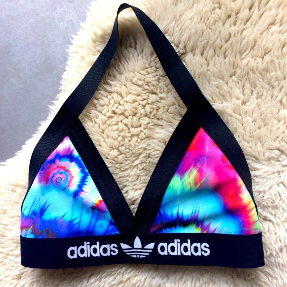My latest handmade reworked Adidas halter neck bralette triangle bra.  Would also look great with a mesh/sheer crop top and shorts/jeans.  It is beautifully structured and lined .  Colours may vary from yellows to pinks to greens and blues. If you have a preference to specific main colour, please leave me a note in the order.  PLEASE PHYSICALLY MEASURE YOUR UNDERBUST TO GET YOUR BAND SIZE.  XS - Under Bust Band size 27.5 AA - A/B Cup S - Under Bust Band Size 28.5 B/C Cup a...