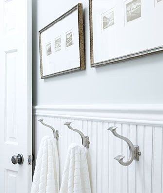 "TIP: If your towels never seem to end up neatly hung on towel bars, why not install a row of hooks that make it easier for everyone to clean up after themselves? Hang the hooks about 42"" off the floor and even the smallest member of your family will be able to reach them!"