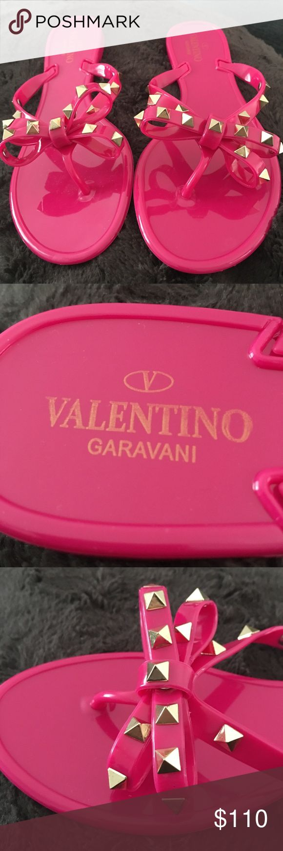 """""""VALENTINO Rockstud Flip Flops"""" Valentino Garavani PVC Rockstud rubber flip flops in bright pink. - Bow detail with warm color palladium-finish studs  - Sole with lace motif  DETAILS Round toeline Contrasting applications  These are a euro size 39. They are more suited for a size 7-7.5. They are gorgeous and elegant, yet casual & fun. They are more beautiful in person!!!! ❤️ **PLEASE DON'T ask the obvious** Price reflects authenticity. 🙌🏼Quality is 1:1...Submit your offers! 😘 ((No Box…"""