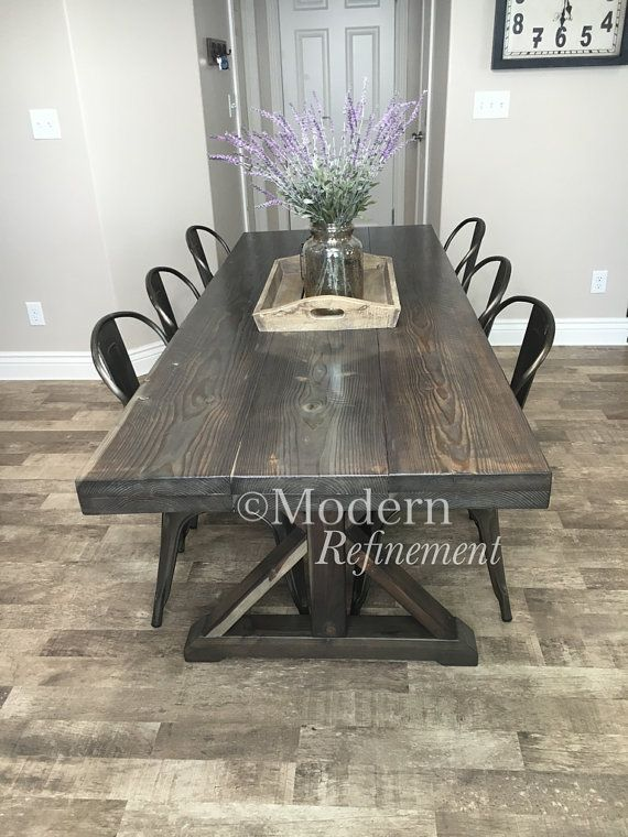Stunning handmade rustic farmhouse table. Just the right accent piece to add to your home. The table is handmade, solid wood and treated with a lovely weathered stain. Has a protective finish to bring out the woods natural beauty. These tables can be customized with any dimensions as well as color combinations. Message me for more details.   Dimensions 86 long 30 tall 33 wide  Farmhouse table. Dinning table. table. Farmhouse. Rustic. Buffet. Sofa table. Table. Entry way. Stained. Stain…