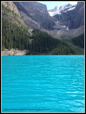 "The beautiful colors of Moraine Lake in Banff National Park in Alberta, Canada! Find out more at ""Down the Wrabbit Hole - The Travel Bucket List"". Click the image for the blog post."