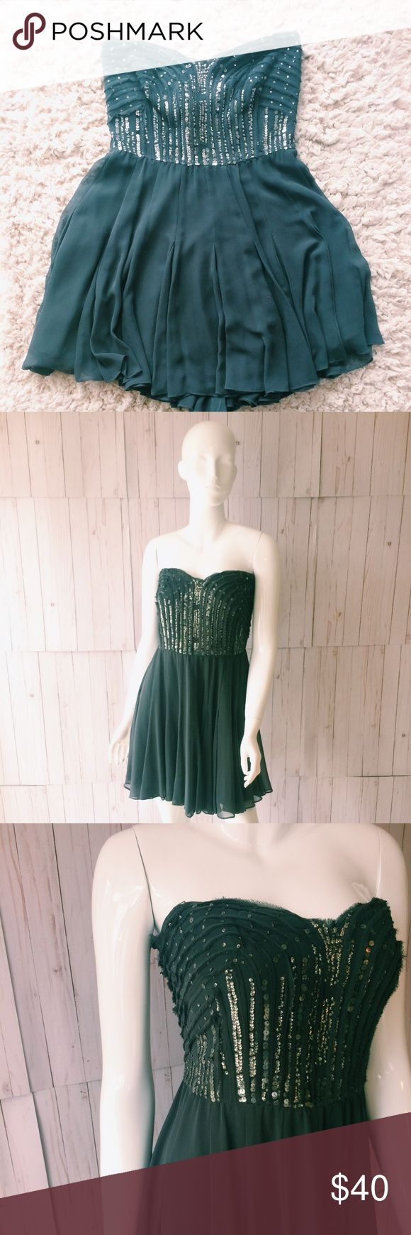 Calvin Klein Strapless Pleated Sequin dress Super cute-easy to wear!  -Stretchy back for comfortable fit -pleats in skirt -raw edge and sequin detail in bodice -EUC-little to no signs of wear Calvin Klein Dresses