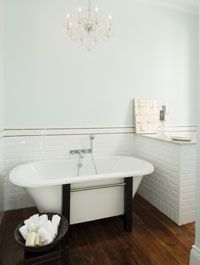 """Walls are painted in Benjamin Moore's """"Iceberg,"""" the ceilings in """"Palest Pistachio,"""" and trim in """"Super White."""""""