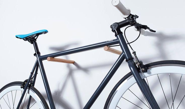 Bike Sticks - Wall Mount Bike Rack / Fenwick / Oak Wood Bike Hook - Modern Minimalist Simple Bicycle Rack Storage by LomaLiving on Etsy https://www.etsy.com/listing/530774169/bike-sticks-wall-mount-bike-rack-fenwick