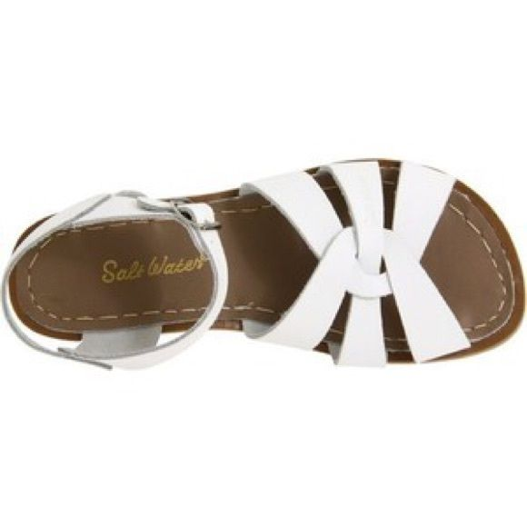White salt waters Original salt water sandals! They've had a lot of love but have a lot more life in them. With a little bit of cleaning up these can be good as new! Salt Water Shoes Sandals