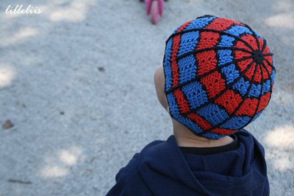 Crochet spiderman hat --- needs flap on the sides so we can tie it up and a big red pom pom on the top!