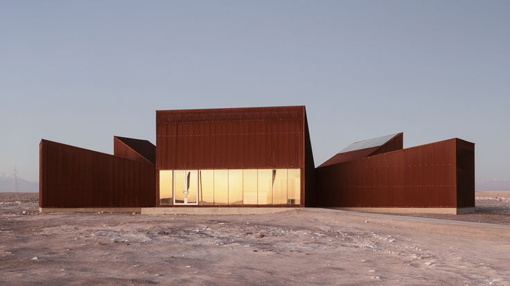 Rusty steel wedges surround desert garden in Chile's Atacama Desert