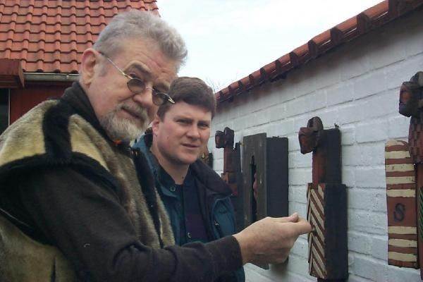 Niels Helledie, famous Danish sculptor Showing off his art work at his house in Skagen, Denmark. By Dean Arnold