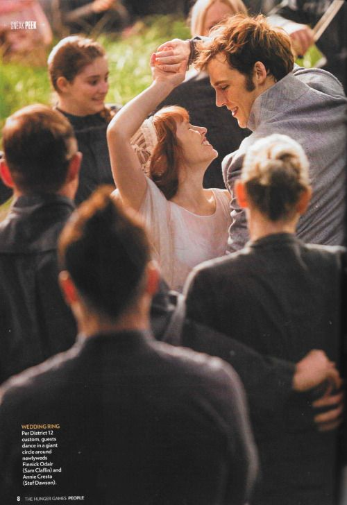 A new still of Finnick and Annie from the People special edition Hunger Games issue!>>> Prim in the background...