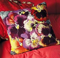 Pansies Cushion. Somebody embroidered or did needlepoint or whatever you call it over this whole thing.