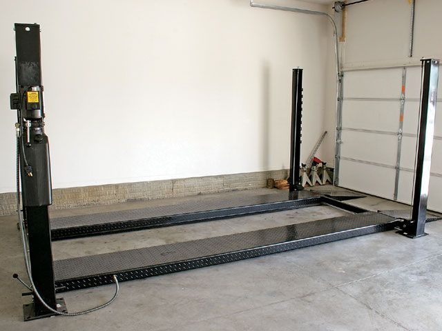car lift just added in the garage for the new car! :O)