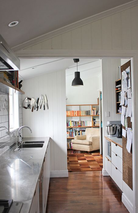 Ashgrovian Queenslander home - View from the kitchen, past the nook into the study Photo by Elizabeth Santillan for Walk Among the Homes www.walkamongthehomes.com.au  #homes #interiors #kitchen #nook #stainlesssteel #bench