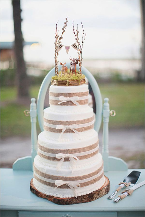 Whimsical Woodland Wedding Cake Pins: 1,000+ Rustic weddings are all the rage right now and this cake would be perfect for a chic woodland fete. The bunting and deer toppers paired with burlap and ribbon trim make this dessert both lovely and unique. Photo via The Wedding Chicks .
