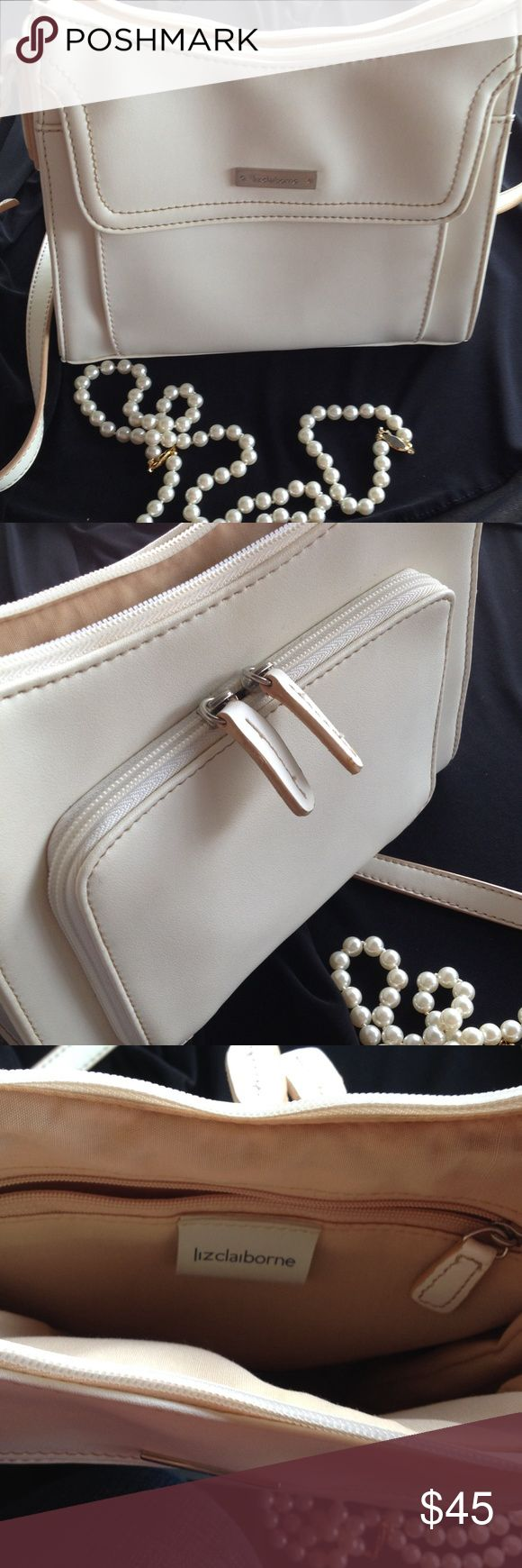 Liz Clairborne Purse Beautiful Liz Clairborne handbad in CREME and TAN. Plenty of space for credit cards, change, and small items on outer pocket, with spacious inside pocket and room for medium sized items such as cosmetics, phone, etc... Very good condition. I hate to part with it👜 Adjustable strap Liz Claiborne Bags Shoulder Bags