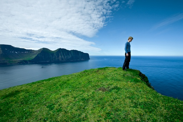 Standing on the edge in Iceland Westfjords.