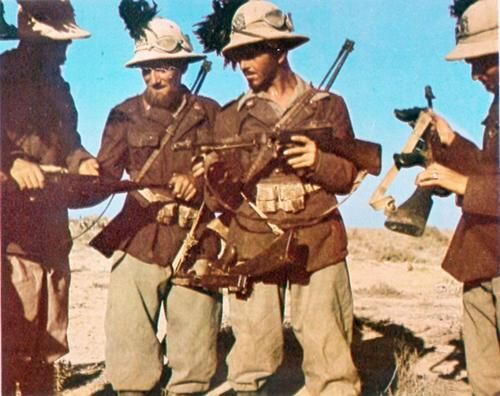 "Italian ""Bersaglieri"" ( assaul troops)  in North Africa with captured Thompsons."