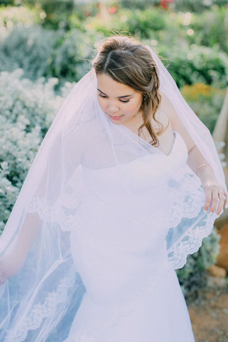 Meylea Bridal // Ruched mermaid dress // white fit and flare // long lace edge veil //