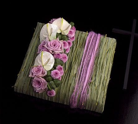 Grass covered box embellished with lavender roses, pom poms and white anthurium - Moniek Vanden Berghe