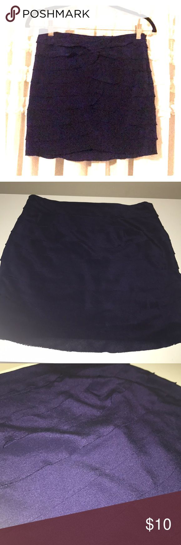 Beautiful Violet Mini Skirt The skirt is a beautiful violet color. It is tiered silk and is very delicate and dainty. It is perfect to wear with a tucked in shirt and wall boots for a stylish winter look! The skirt is dry clean only and is fully lined. The lining is 100% polyester. Forever 21 Skirts Mini