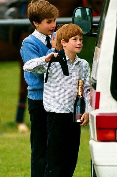 May 02, 1993: Prince Harry carrying a champagne while at a polo match. Behind him is his brother Prince William.
